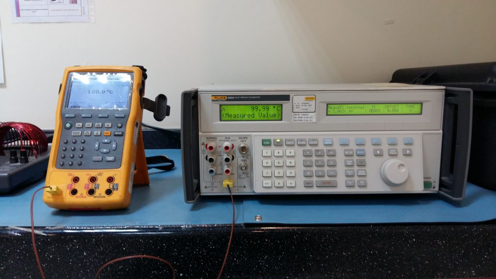 Thermocouple wire simulation using a multi-product calibrator and a digital thermometer.