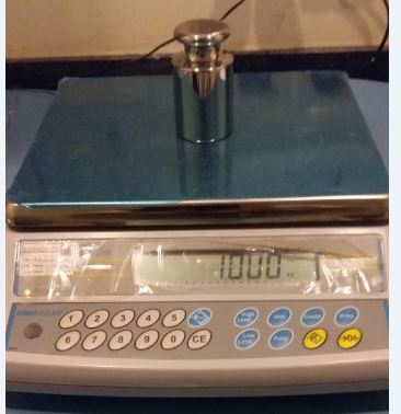 weighing-scale-with-standard-mass