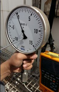 Pressure Gauge with adjustable screw inside its mechanical.
