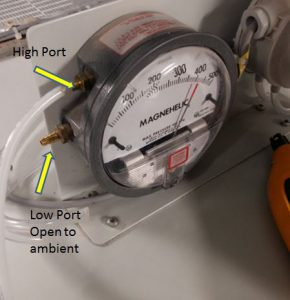 Connecting the pneumatic hose in the positive or high side while leaving low side open to atmosphere or ambient