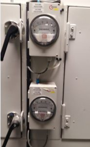 A differential pressure gauge installed in the vents or hoods.